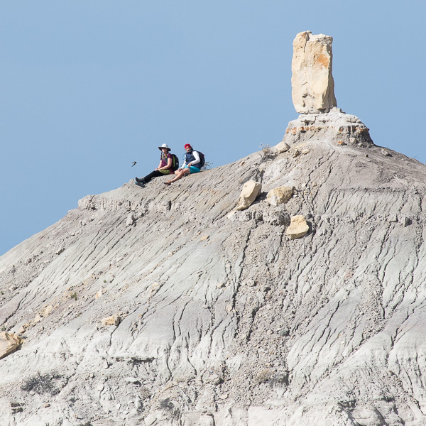 Hikers on the ridge in front of Angel Peak, Bloomfield NM, October 19, 2015