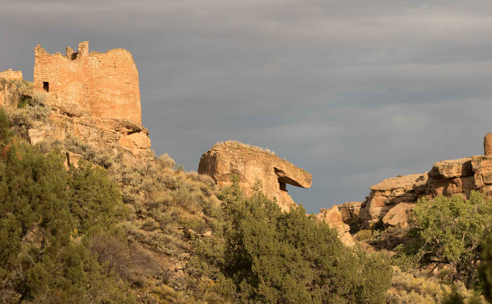 Twin Towers and Eroded Boulder House lit by the rising sun after a rainy night, Hovenweep National Monument, Aneth UT, September 30, 2016